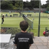 A Young Competition Organiser watches the courts