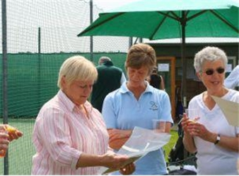 Members admiring their Clubmark plaque