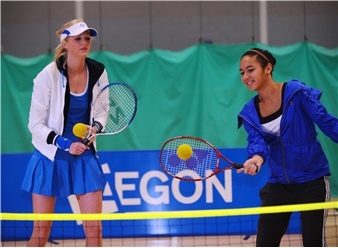 Junior US Open Champion Heather Watson gets some pointers from tennis coach and Miss Scotland 2009 Katherine Brown